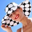 Sophisticated woman with hat — Stock Photo