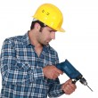 Handyman using power drill - Photo