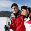 Stock Photo: Young ski couple