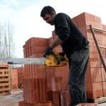 Man sawing through bricks — Stock Photo #9174549
