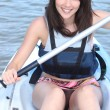 Young woman canoeing — Stock Photo