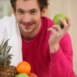 Young man and fruits — Stock Photo #9176706