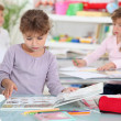 Stock Photo: Little girls studying in classroom