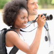 Stock Photo: Couple taking photographs of wild life