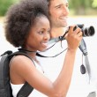 Couple taking photographs of wild life — Stock Photo #9177745