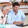 Happy doing accounting at home — Stock Photo #9177991