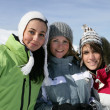 Three female friends skiing — 图库照片