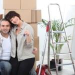 Couple celebrating their new apartment — Stock Photo