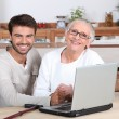 Help senior with computer — Stock Photo #9179948