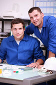 Two warehouse workers taking inventory — Stock Photo