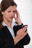 Businesswoman receiving bad news on her cell — Stock Photo