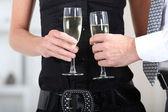 Hands holding wine glasses — Stock Photo
