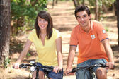 Young on bikes — Stock Photo