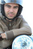 Young man on a motorbike — Stock Photo