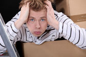 Overwhelmed man on moving day — Stock Photo