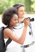 Couple taking photographs of wild life — Stock Photo