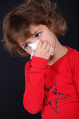 Little girl blowing her nose — Stock Photo