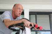 Elderly man working out — Stock Photo