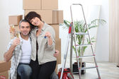 Couple celebrating their new apartment — Stock Photo