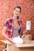 Portrait of a woman with moving boxes — Stock Photo