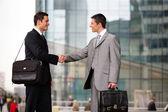 Businessmen handshaking outdoors — Stock Photo