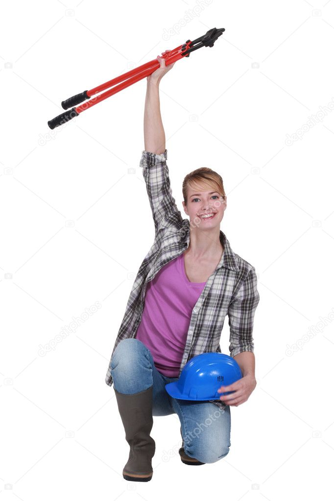 Tradeswoman holding a pair of large clippers in the air — Stock Photo #9170397