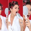 Brunette wearing bathrobe with hair curlers holding hairbrush holding  agai - Stok fotoğraf