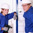 Female and male electrician — Stock Photo