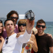 Friends on holiday with a video camera — Stock Photo