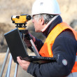 Royalty-Free Stock Photo: Site surveyor taking readings