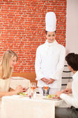 Couple complimenting the chef on her cooking — Stock Photo