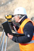 Site surveyor taking readings — Stock Photo