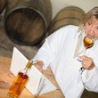 Wine expert tasting wine in cellar — Stock Photo #9198560