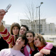 Stock Photo: Teens taking a picture of themselves with a mobile phone