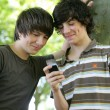 Teenagers playing with cellphone — Stock Photo