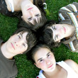 Teenagers lying in the grass — Stock Photo #9198708