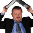 Man holding laptop over head — Stock Photo #9198759