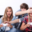 Teenagers playing video games — Stock Photo