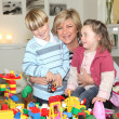 Mother playing with children — Stock Photo