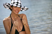 Thumbs up from a woman on the beach — Stock Photo