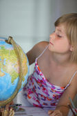 Little girl looking at a globe — Stock Photo