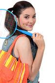 Woman going to play badminton — Stock Photo