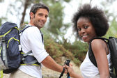 Couple rambling in woods — Stock Photo