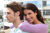 Relaxed young couple in the city — Stock Photo