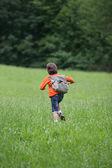 Boy running through the grass — Stock Photo