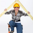 Construction worker with a timber apex - Stock Photo