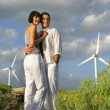 Stock Photo: Couple in front of wind farm
