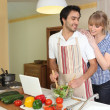 Young man making a salad with his partner — Stock Photo #9201252
