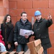 Couple having their new home inspected by engineer — стоковое фото #9201404