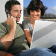 Elated couple learning happy news - Stock Photo